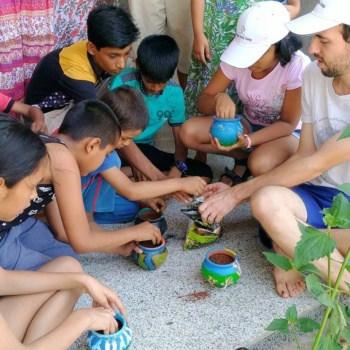 Children Filling Plant Pots with Soil