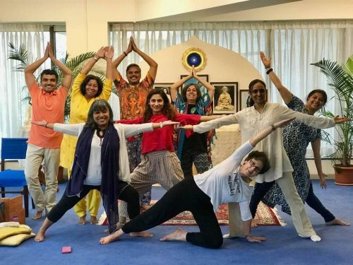 New Ananda Yoga Teachers in Different Poses