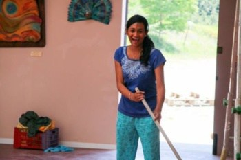 Young Woman Cleaning with Big Smile